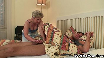 Cock-hungry mother in lawawakes him for sex