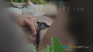 Skinny french nudist teen peeing and masturbating on a public beach